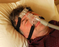 CPAP machine anti-snoring device
